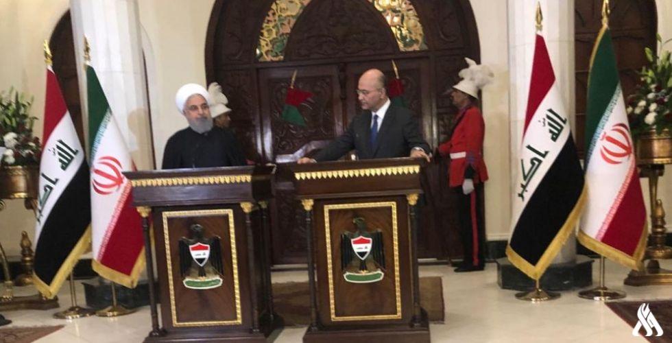 الرئيسان صالح وروحاني خلال مؤتمرهما الصحافي في بغداد