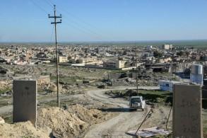 منظر عام لبعض المباني المدمرة في سنجار بشمال العراق في 4 شباط/فبراير 2019.