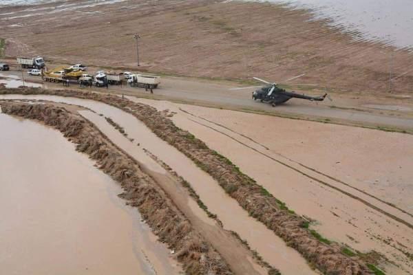 عمليات إنقاذ لعراقيين تحاصرهم السيول