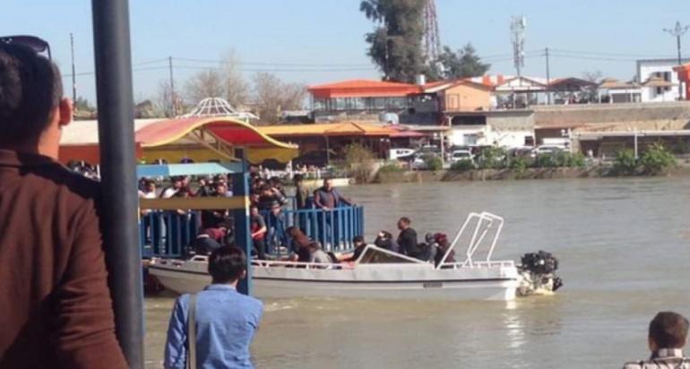 عمليات الانقاذ بغرق العوامة في المدينة السياحية بالموصل