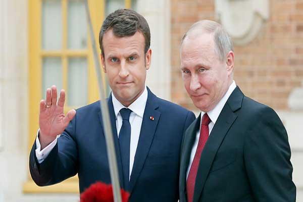 الرئيسان الروسي والفرنسي خلال لقاء سابق