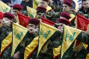 مقاتلون من حزب الله خلال عرض عسكري في ضاحية بيروت الجنوبية - ارشيفية