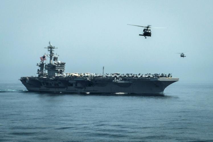 صورة التقطت في 13 أبريل 2019 لحاملة طائرات أميركية في خليج عمان