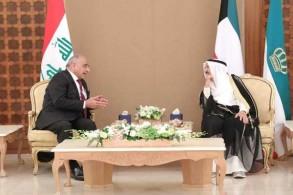 عبد المهدي مجتمعًا مع أمير الكويت