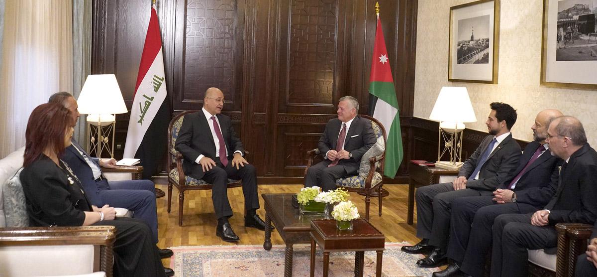 الرئيس العراقي والعاهل الاردني خلال اجتماعهما في عمان