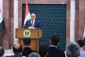 عبد المهدي متحدثا خلال مؤتمره الصحافي الاسبوعي