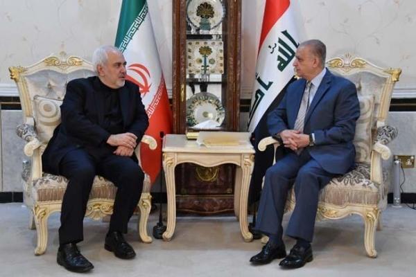 ظريف والحكيم خلال اجتماعهما في بغداد