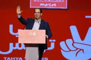رئيس الوزراء التونسي يوسف الشاهد متحدثا في ضاحية تونس في الاول من مايو 2019