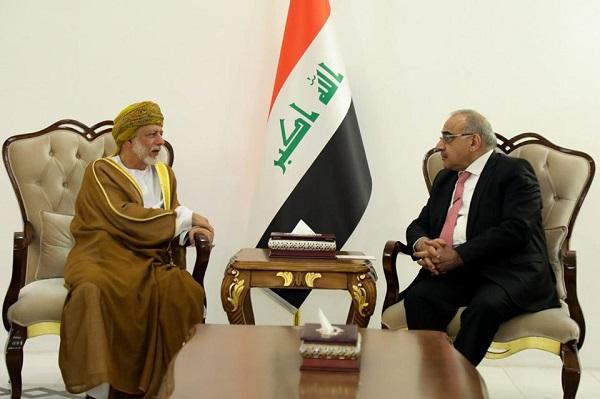 عبد المهدي وبن علوي خلال اجتماعهما في بغداد