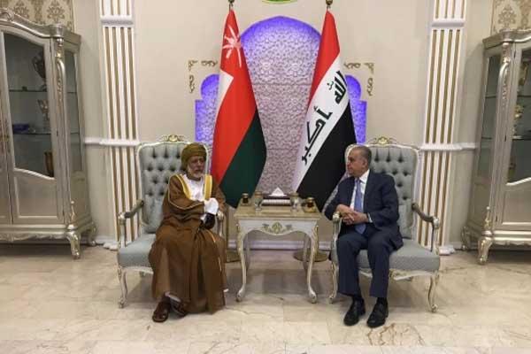 بن علوي في بغداد مستقبلا من نظيره العراقي الحكيم