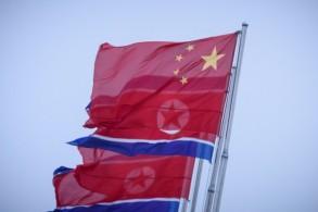 أعلام صينية وكورية شمالية في ساحة كيم إيل سونغ في بيونغ يانغ - الأربعاء 19 يونيو 2019