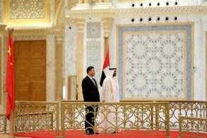ولي عهد ابوظبي الشيخ محمد بن زايد مستقبلا الرئيس الصيني شي جينبينغ في أبوظبي في 20 يوليو 2018