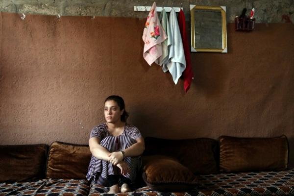 الأيزيدية جيهان قاسم التي تركت ثلاثة أطفال مولودين من أب جهادي في سوريا لتقبل بين مجتمعها وطائفتها في العراق متحدثة الى وكالة فرانس برس في 25 يونيو 2019