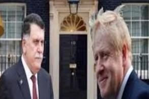 جونسون والسراج (صورة عن موقع أخبار ليبيا)