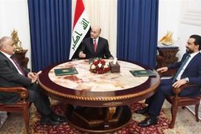 الرؤساء العراقيون الثلاثة للجمهورية والحكومة والبرلمان خلال اجتماعهم في بغداد اليوم