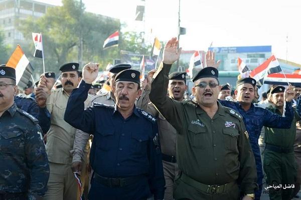 خروج أول مظاهرة عسكرية في العراق دعمًا للمحتجين