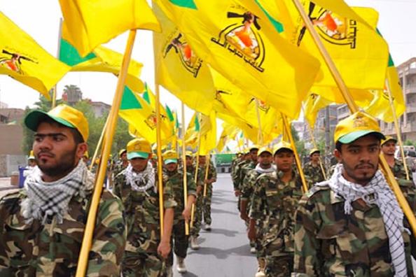 عناصر حزب الله العراقي يحرقون صور القازمي!