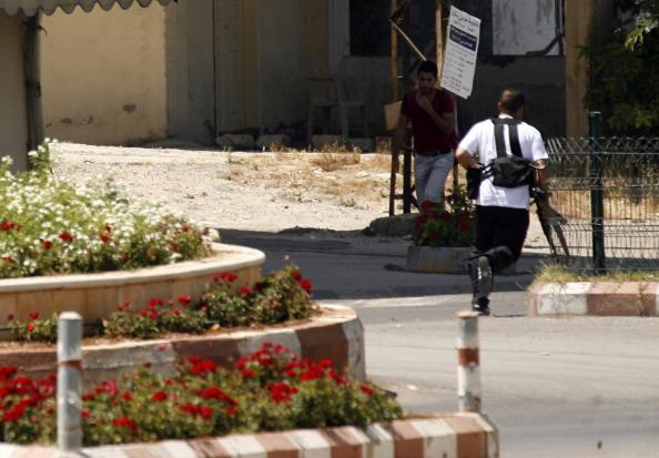 مسلح من أنصار الأسير خلال الاشتباكات في صيدا
