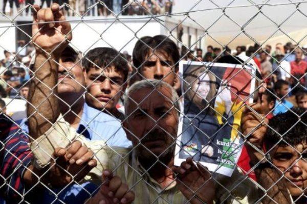 لاجئون سوريون في مخيم في شمال العراق