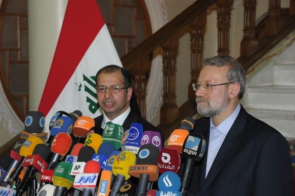 الجبوري ولاريجاني خلال مؤتمرهما الصحافي في طهران