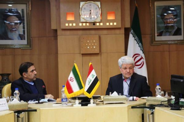 وزير النقل العراقي باقر الزبيدي إلى جانب نظيره الإيراني عباس اوخندي