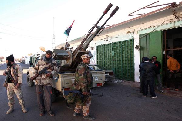 الميليشيات حولت آمال الثورة في ليبيا إلى دولتين متناحرتين