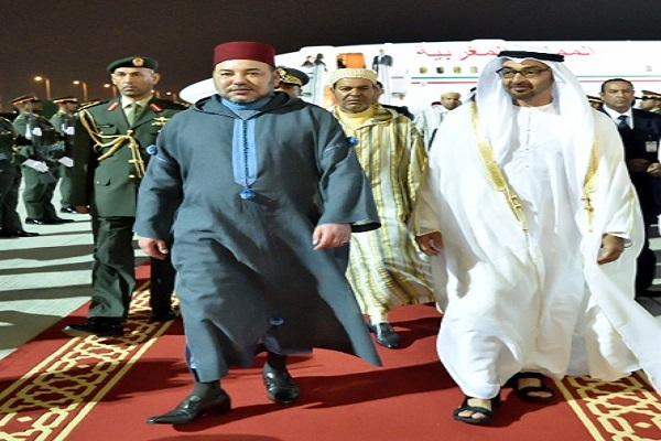 الشيخ محمد بن زايد لدى استقباله الملك محمد السادس