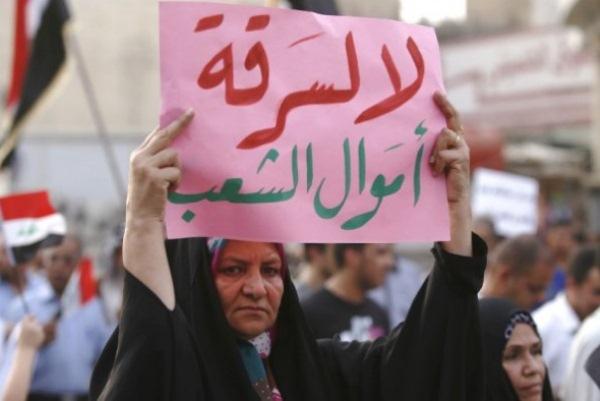 امرأة عراقية خلال تظاهرة ضد الفساد