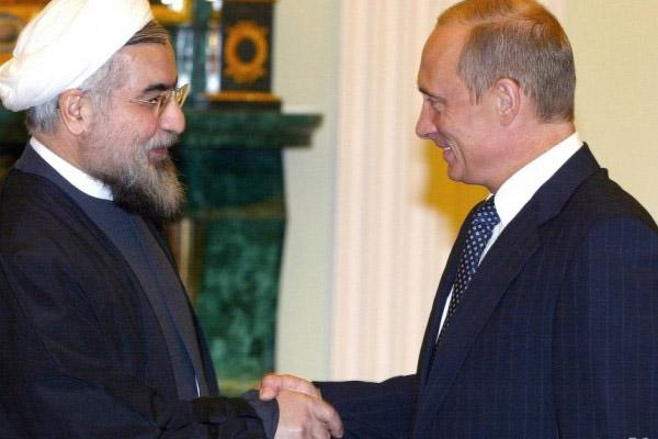 بوتين وروحاني في لقاء سابق