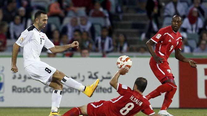 من مباراة العراق وفلسطين