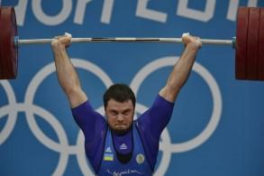 الرباع الأوكراني أوليكسي توروختيي خلال منافسات وزن ما دون 105 كلغ في دورة الألعاب الأولمبية