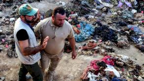 العراق يعمل على تحديد هويات رفات المئات من ضحايا تنظيم الدولة الإسلامية