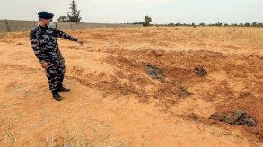 25 جثة مجهولة الهوية في خمس مقابر جماعية غرب ليبيا