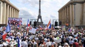 تظاهرات في فرنسا وأستراليا احتجاجًا على قيود كوفيد