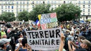 فرنسيون ملقحون ضد كوفيد يؤيدون اللقاح ويعارضون الشهادة الصحية